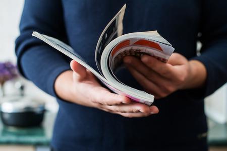 reading materials: Man reads magazine