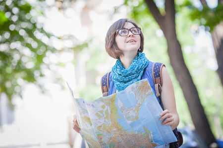 peters: Pretty young female tourist studying a map Stock Photo