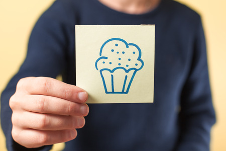 lots: drawing image cupcake in hand Stock Photo