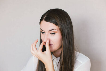 young girl smelled bad smell photo