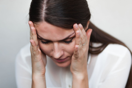 young sad girl headache Stock Photo
