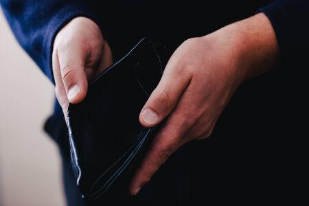 Hands hold an empty purse Banco de Imagens