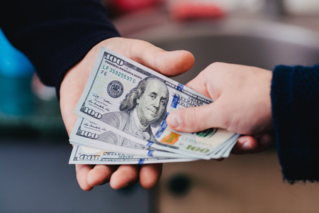 Give money from hand to hand