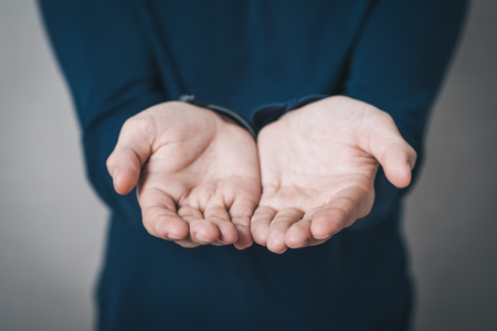 charitable: Man showing empty hands on Gray background Stock Photo