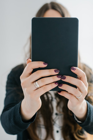 woman with tablet computer screen smiling