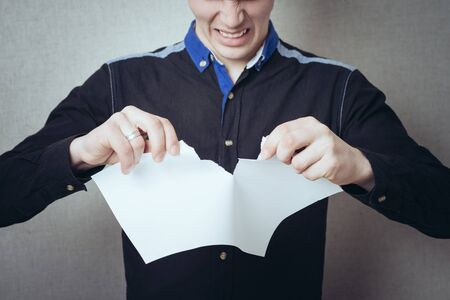 white sheet: Businessman tearing the contract, a white sheet.