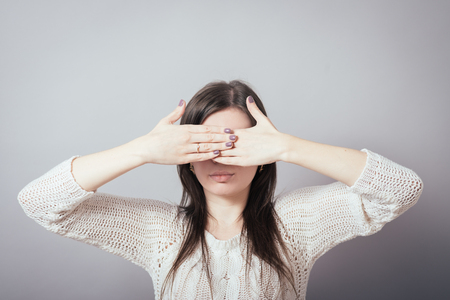 closes eyes: .girl closes eyes with her hands