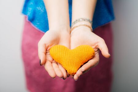 chose: girl holding a toy a little heart