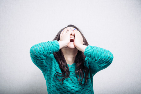 hysterics: Pretty girl in hysterics covers her face Stock Photo