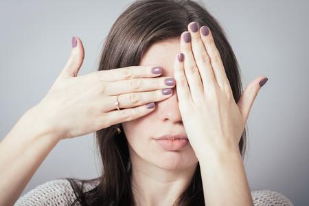 closes eyes: girl closes eyes hands