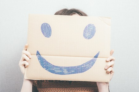 girl shows a happy smiley 版權商用圖片