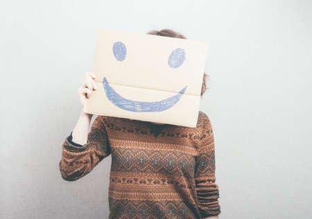 girl shows a happy smiley Imagens