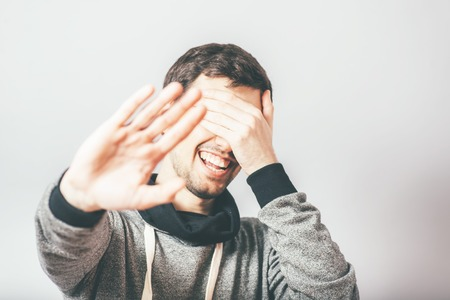 man does not want to be photographed Stock Photo