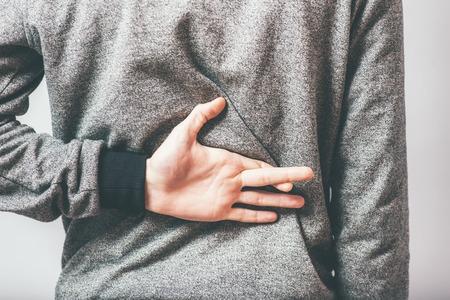 trickery: man crossed his fingers