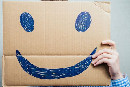 anonym: man holding a happy smiley Stock Photo