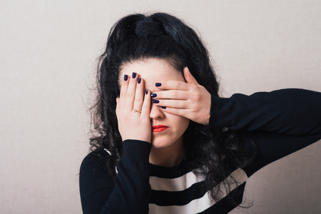 hands covering eyes: girl covering her eyes with her hands