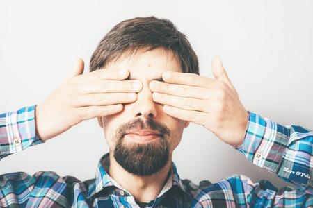closes eyes: man closes his eyes