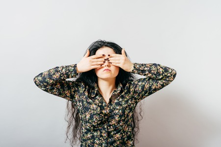 closes eyes: girl closes her eyes Stock Photo