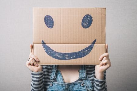 girl holding a happy smiley Фото со стока