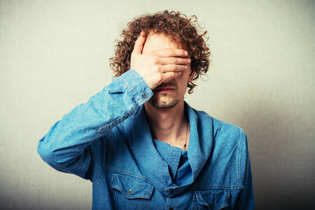 unsighted: Portrait Of An Businessman Covering Eyes Isolated On Grey Background Stock Photo