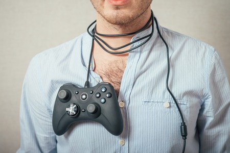 young man holding video game joystick.