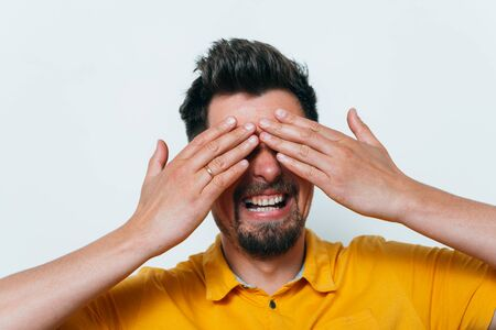 Man closes eyes with her hands Stockfoto