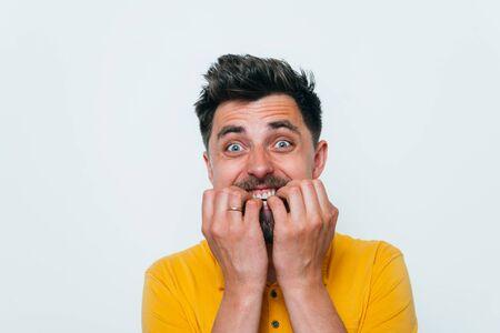man bites his nails