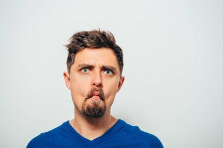 Man sucks his cheeks