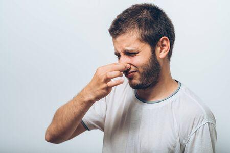 The stench. Closes the man's nose Reklamní fotografie