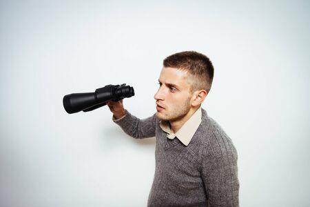 man with binoculars. gray background
