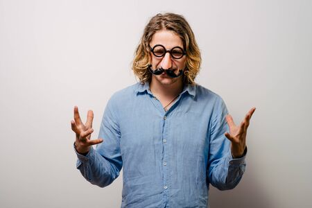 a man of a fake nose and glasses, with mustache and furry eyebrows