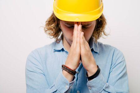 Construction worker praying