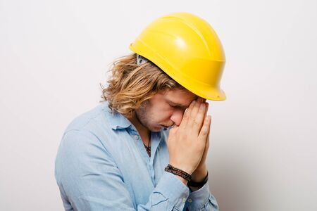 Construction worker praying