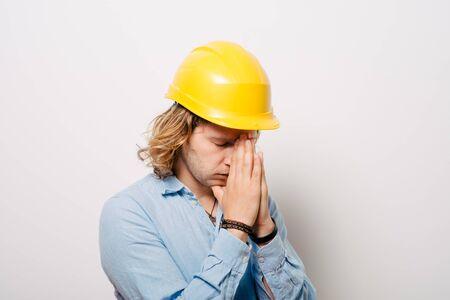 Construction worker praying Stock fotó