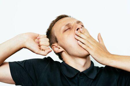 Yawns. Man