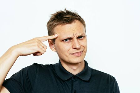 Closeup portrait of angry man gesturing with his finger against his temple, are you crazy?