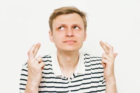 man crosses his fingers. Good luck, hope Imagens