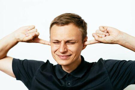 Close ears man Stockfoto