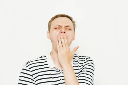 Yawns. Man Stock Photo