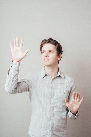 young man showing pantomimes 版權商用圖片