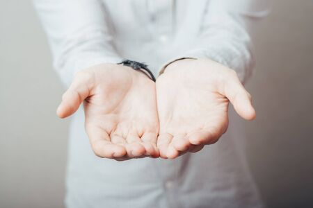 man's hands holding something invisible