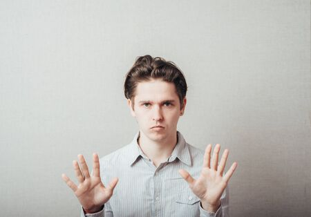 young man crossed his arms showing stop Stock Photo