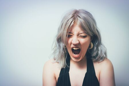 Woman angry and screaming .