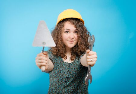 girl in a yellow helmet with a key