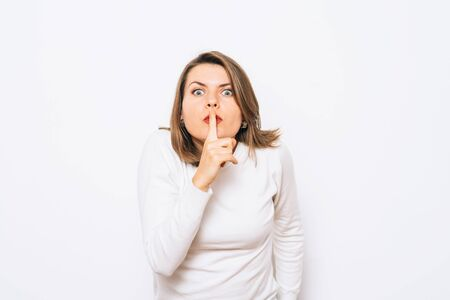 woman put finger on her lips