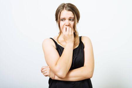Woman bites his nails