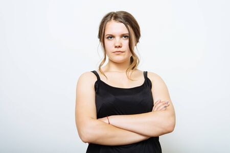 Portrait of a woman arms folded Imagens