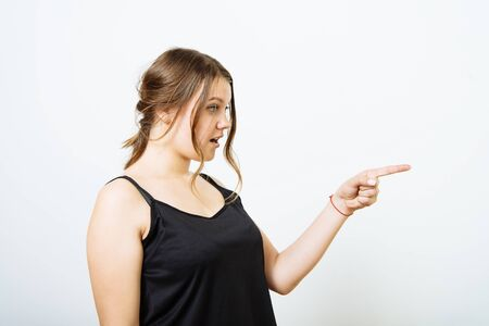 girl points to someone the finger