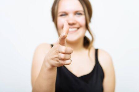studio portrait of a beautiful girl pointing to the camera Zdjęcie Seryjne