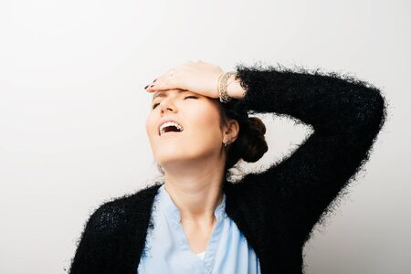 The girl headache, with hand on her head. Isolated on a white background